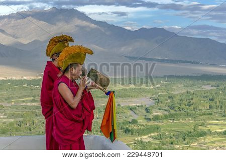 Hemis, India - August 12, 2017: Buddhist Monks  Blowing Into A Tibetan Specific Instrument At The He