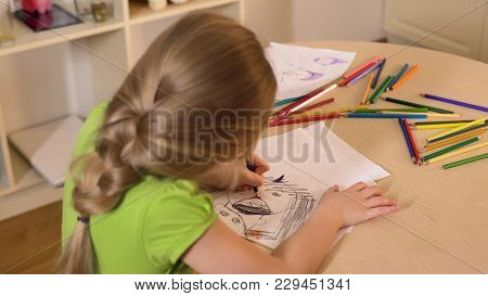 Little Girl Drawing Stranger From Her Nightmare With Black Pencil, Child Fears, Stock Footage