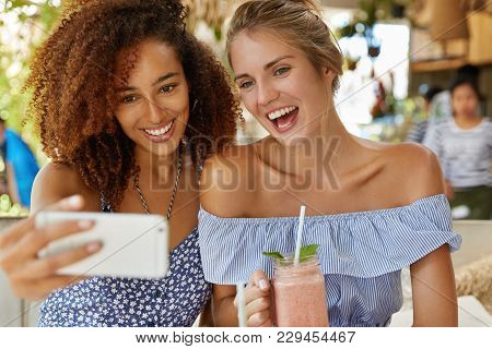 Cheerful Young Women Or Female Student Glad To Pose For Selfie Or Make Video Call On Smart Phone, Sp