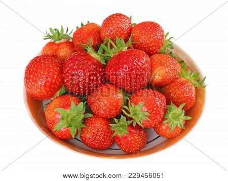 Red Strawberry On Porcelain Saucer Isolated Background