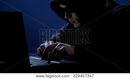 Criminal Secretly Using Laptop, Unauthorized Access To Confidential Information, Stock Footage