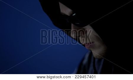 Male Thief In Hoodie And Sunglasses, Preparation Before Offense, Face Close Up, Stock Footage