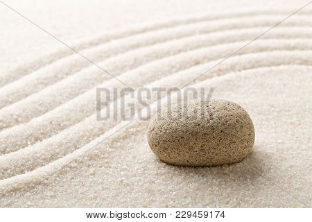 Zen sand and stone garden with raked curved lines with selective focus. Simplicity, concentration or calmness abstract concept poster