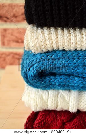 Knitted Clothes Of Different Colours Are Piled Carefully