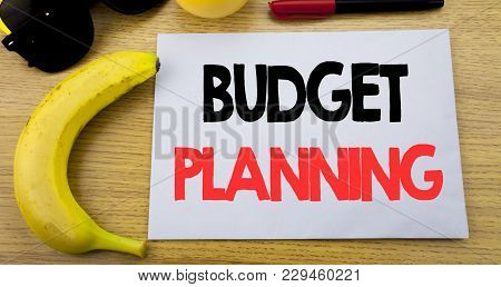 Budget Planning. Business Concept For Financial Budgeting Written On Note Empty Paper, Wooden Backgr