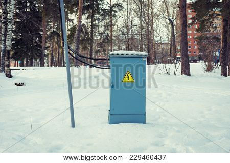 Electrical Control Box With A Danger Sign Installed Outside In The Winter Park