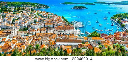 Panorama Of Amazing Coastal Town Hvar In Croatia, Popular Mediterranean Tourist Resort In Summertime