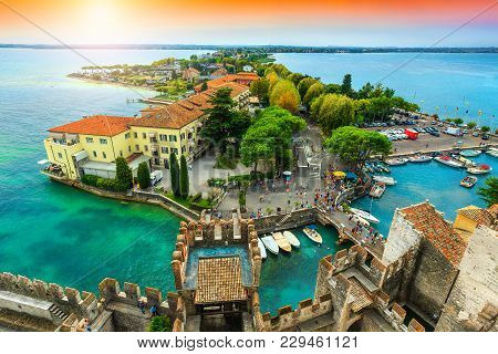 Amazing View To The Old Bridge And Harbor Of Sirmione, From The Scaliger Castle With Lake Garda In B