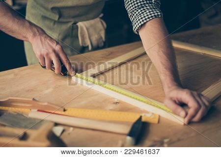 Cropped Close Up Photo Of Cabinet-maker's Strong Hands, The Master Is Measuring A Wooden Frame Using