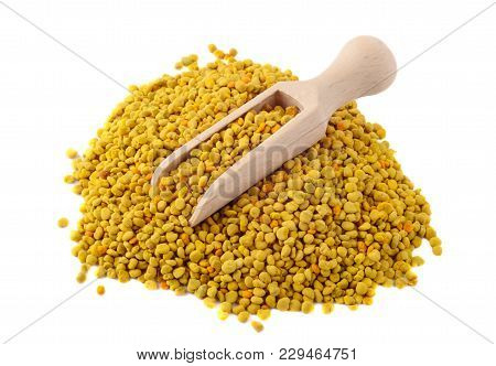 Flower Bee Pollen And A Wooden Slove Is Isolated On A White Background. Natural Remedy For Immunity