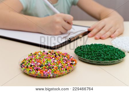 Laboratory Assistant Inspections Plastic Pellets For Industry. Plastic Raw Materials In Granules . P