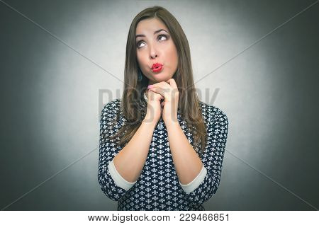 Guilty Ashamed Woman Is Looking Aside Isolated On Gray Background. Offended Girl.