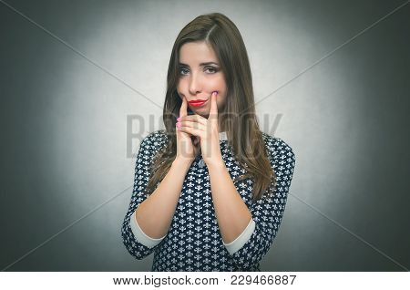 Sad Offended And Disappointed Woman Is Thinking Isolated On Gray Background.