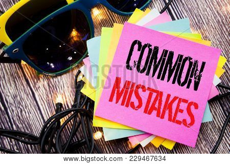 Word, Writing Common Mistakes. Business Concept For Common Concept Written On Old Wood Wooden Backgr