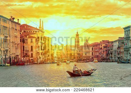 Gondola With Gondolier Near Rialto Bridge Grand Canal In Venice, Italy During Sunset. Venice Postcar