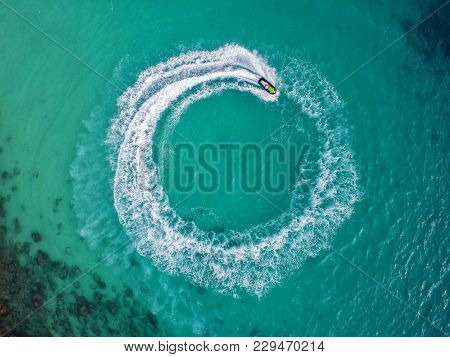 People Are Playing Jet Ski At Sea During The Holidays.