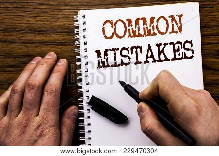 Handwritten Text Showing Word Common Mistakes. Business Concept For Common Concept Written Tablet La