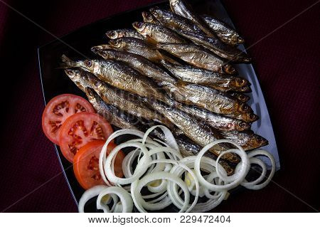 Smoked River Fish Served With Tomatoes And Onions. The View From The Top.