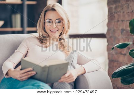 Attractive Charming Cheerful Happy With Beaming Smiling Mature Woman Wearing Round Spectacles Is Rea