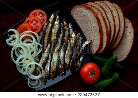 Smoked River Fish Is Served With Bread, Tomatoes, Spices And Onions. The View From The Top.