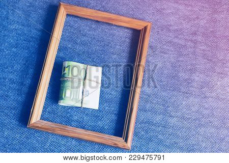 Bundle Of Euro Money In A Frame On A Blue Background