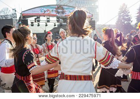 Pernik, Bulgaria - January 26, 2018: Group Of Girls And Boys In Traditional Bulgarian Folklore Costu