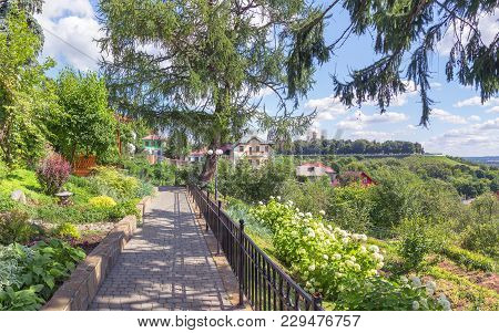 A Picturesque View With Flowers Along The Alley In The Patriarchal Garden. Vladimir, Russia