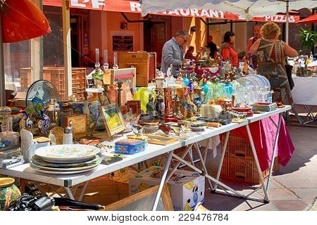 Nice, France - May 13,2013: Market Stall At The Famous Antique Market Cours Saleya Every Monday In N