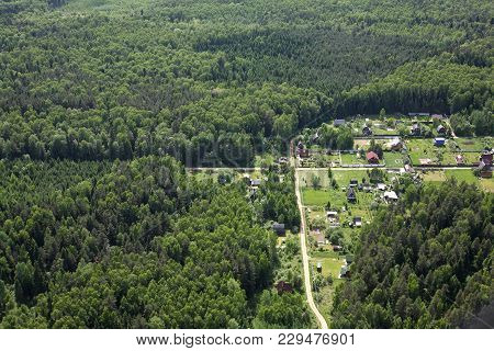 Aerial Views - Russia. Russian Village In The Coniferous Mixed Coniferous Forest. Shooting From The