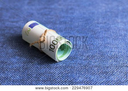 The Eurocurrency Rolls On A Blue Background