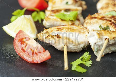 Grilled Chicken Skewer With Cilantro On Slate