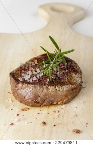 Grilled Steak With Salt And Rosemary On Wood