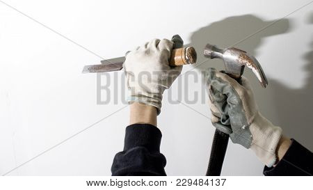 Chisel And Hammer Working Composition In A White Backgorund