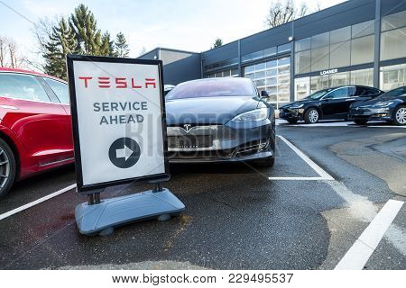 Fuerth / Germany - March 4, 2018: Tesla Service Sign Near A Car Dealer. Tesla, Inc. Is An American C