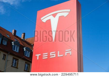 Fuerth / Germany - March 4, 2018: Tesla Logo Near A Car Dealer. Tesla, Inc. Is An American Company T