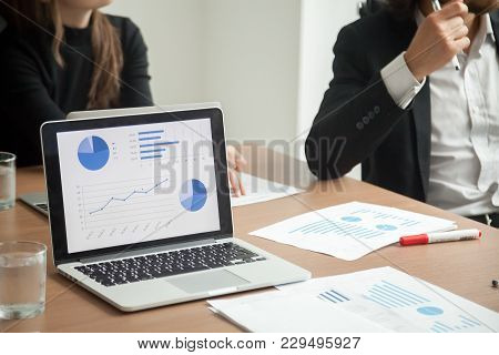 Executive Team Analyze Statistics Data At Corporate Meeting, Reviewing Report Or Work Result Discuss