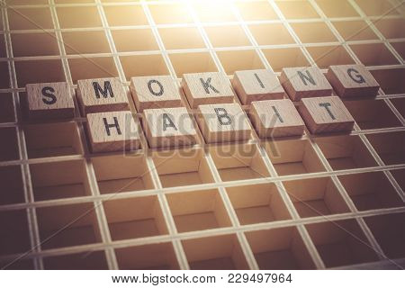 Macro Of The Words Smoking Habit Formed By Wooden Blocks In A Type Case