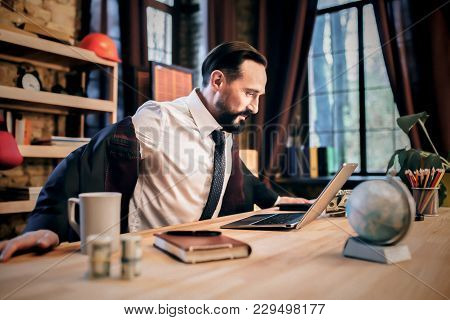 Office Space. Businessman Talking On Skype To Abroad Partner.