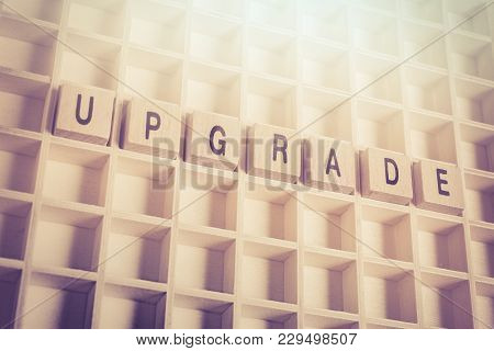 Macro Of The Word Upgrade Formed By Wooden Blocks In A Type Case