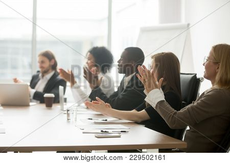 Multiracial Business People Applauding Sitting At Conference Table, Diverse Team Clapping Hands Afte