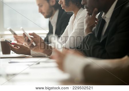 Diverse Office People Working On Mobile Phones, Corporate Employees Holding Smartphones At Meeting,