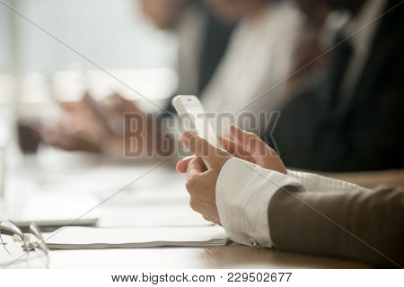 Businesswoman Using Mobile Phone At Office Meeting, Female Hands Holding Smartphone, Woman Employee