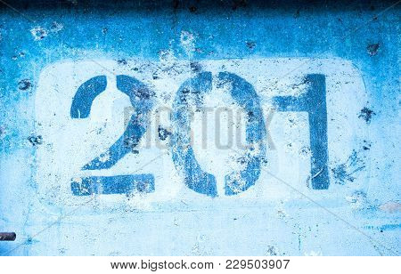 The Number 2 0 1 On The Blue Wall, Two Hundred And One.