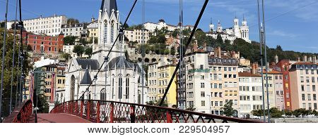 Lyon City With Red Footbridge On Saone River