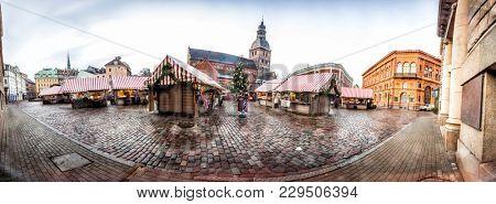 Christmas Market in Riga Dome Square, Latvia. 180 degree panoramic montage