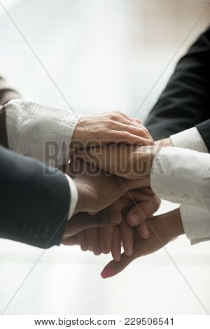Stacked Pile Of Hands Close Up Vertical View, Motivated Multi-ethnic Business Team Join Together As