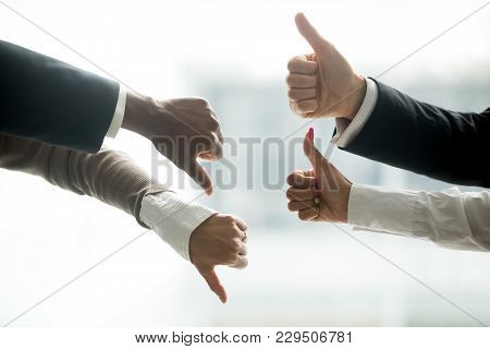 Hands Of Diverse Business People Showing Thumbs Up And Down, Like Versus Dislike Gesture, Positive N
