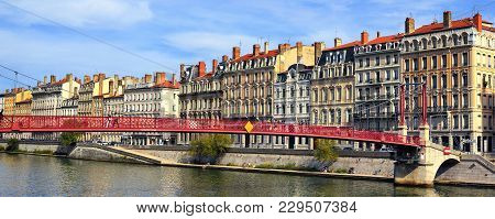 Lyon City And Red Footbridge On Saone River