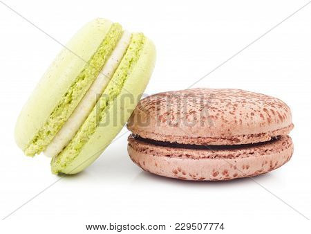 A French Sweet Delicacy, Macaroons Closeup. Isolated On White Background.