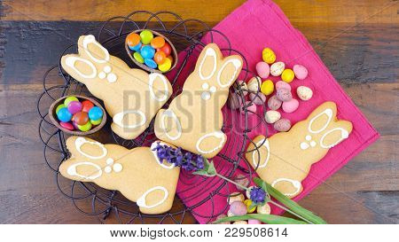 Happy Easter Overhead With Easter Bunny Cookies And Decorations On A Wood Table Background